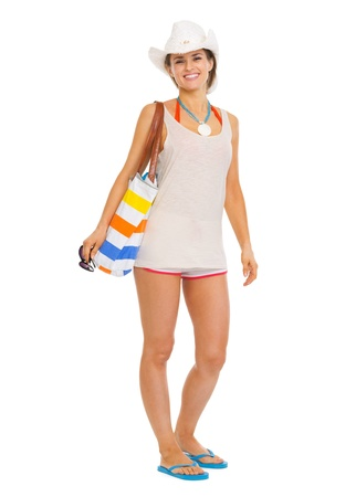 woman beach: Full length portrait of happy young woman with beach bag