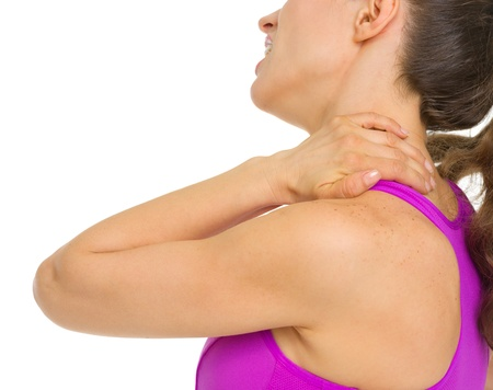 sports injury: Closeup on woman with neck pain Stock Photo