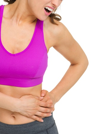 Closeup on woman with stomach pain photo