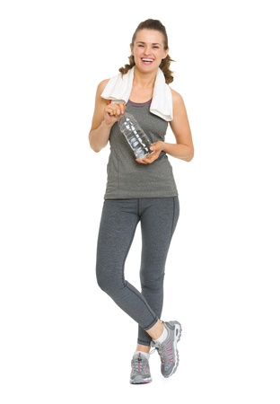 Full length portrait of happy fitness young woman with bottle of water photo