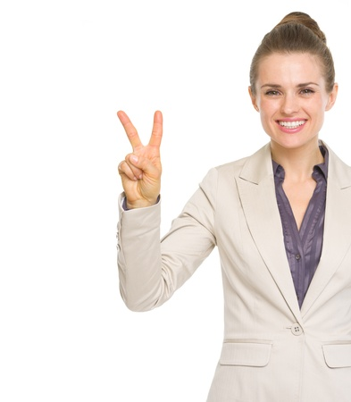 Happy business woman showing victory gesture Stock Photo - 20550539