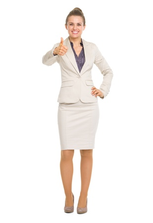 Full length portrait of smiling business woman showing thumbs up Stock Photo - 20443834