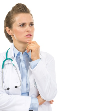 Portrait of thoughtful doctor woman looking on copy space Stock Photo - 20550537