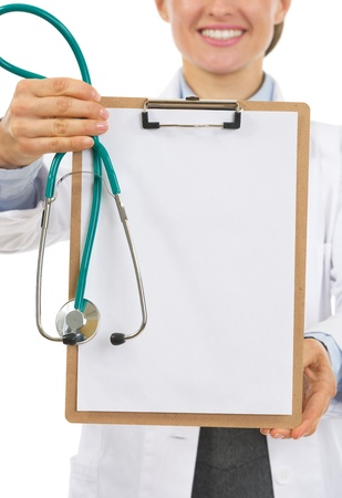 Closeup on clipboard in hand of doctor woman photo