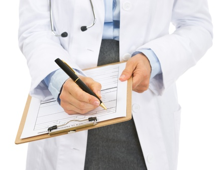 Closeup on doctor woman writing in clipboard photo