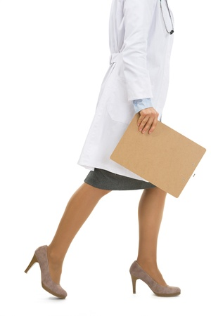 Closeup on doctor woman with clipboard going sideways Stock Photo - 20467246