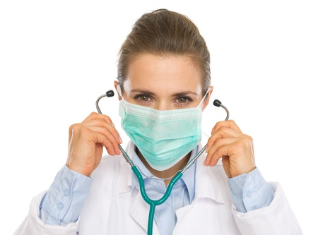 Doctor woman in mask using stethoscope Stock Photo - 20467235