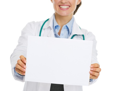 Closeup on blank paper sheet in hand of smiling doctor woman Stock Photo - 20467217