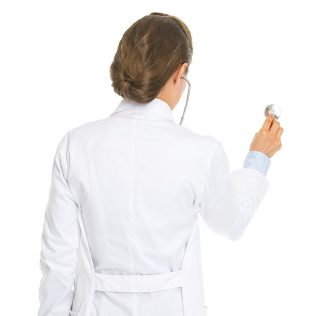 Doctor woman using stethoscope . rear view Stock Photo - 20443840