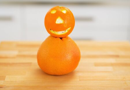 Closeup on orange with funny face Stock Photo - 20545303