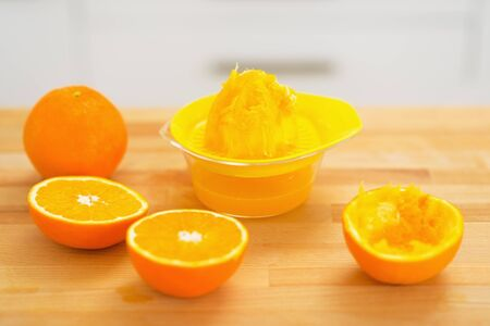 Closeup on oranges and juicer press on cutting board Stock Photo - 20545302