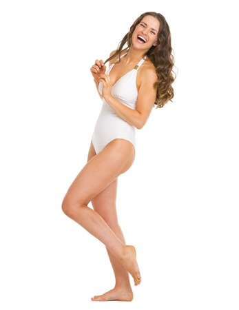 Full length portrait of smiling young woman in swimsuit Stock Photo - 20542773