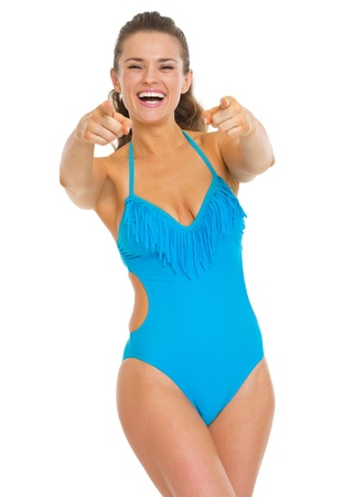 Happy young woman in swimsuit pointing in camera Stock Photo - 20542754