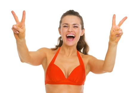 Happy young woman in swimsuit showing victory gesture Stock Photo - 20542742