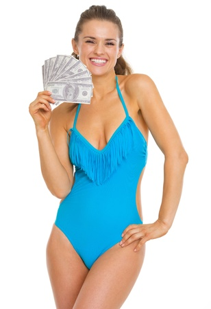 Smiling young woman in swimsuit holding fan of dollars Stock Photo - 20542650