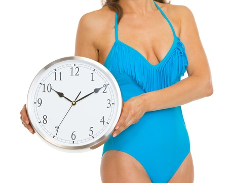 Closeup on woman in swimsuit showing clock Stock Photo - 20542750