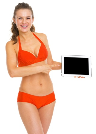 Happy young woman in swimsuit pointing on tablet pc blank screen Stock Photo - 20542718