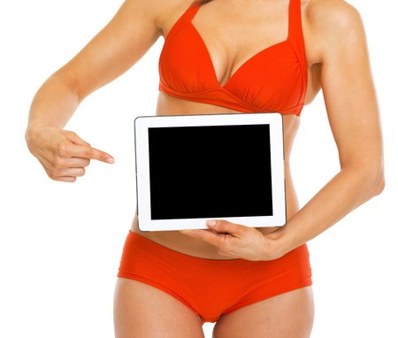 Closeup on woman in swimsuit pointing on tablet pc blank screen photo
