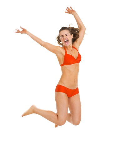 Happy young woman in swimsuit jumping Stock Photo - 20542779
