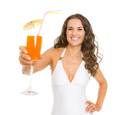Smiling young woman in swimsuit giving cocktail Stock Photo - 20542783