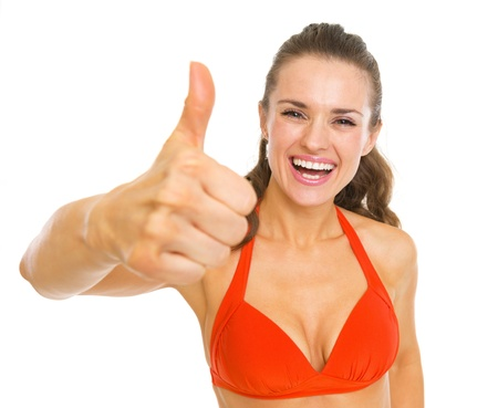 Happy young woman in swimsuit showing thumbs up Stock Photo - 20542787