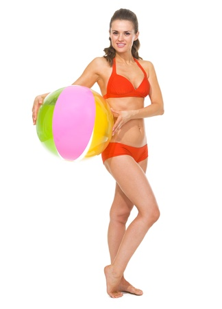 Full length portrait of young woman in swimsuit with beach ball Stock Photo - 20542798