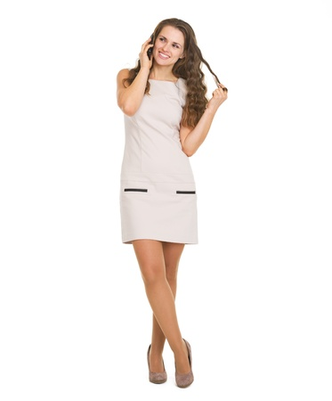 Full length portrait of happy young woman talking cell phone Stock Photo - 20671586
