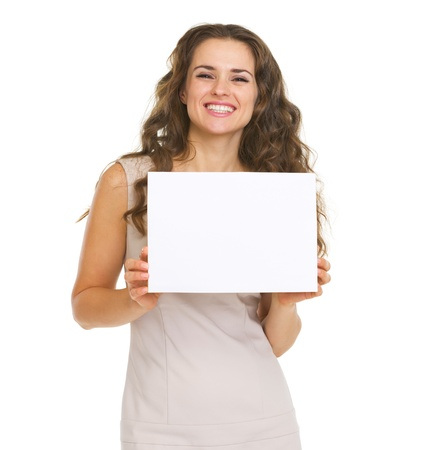 Portrait of happy young woman showing blank paper Stock Photo - 20671416
