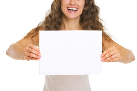 Closeup on smiling young woman showing blank paper Stock Photo - 20671420