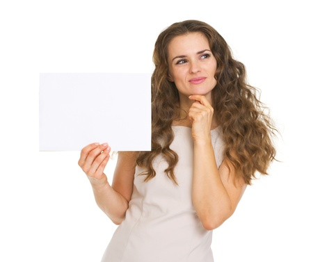 Thoughtful young woman holding blank paper Stock Photo - 20671423