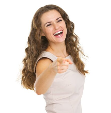 Smiling young woman pointing in camera Stock Photo - 20857095