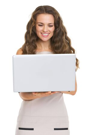 topicality: Happy young woman using laptop