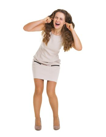 Full length portrait of frustrated young woman closing ears with fingers Stock Photo - 20857116