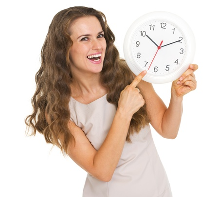 Smiling young woman pointing on clock Stock Photo - 20857134