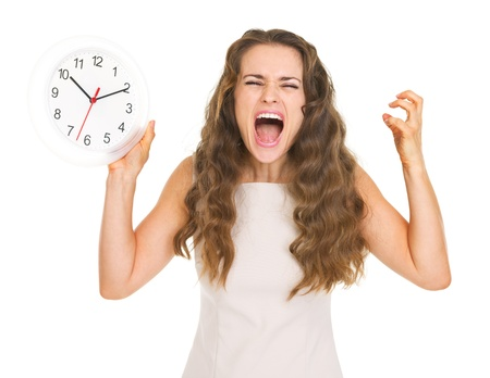 Stressed young woman with clock Stock Photo - 20857117