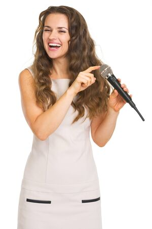 Happy young woman checking microphone Stock Photo - 20857140