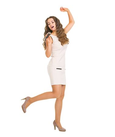 Full length portrait of happy young woman singing in microphone Stock Photo - 20857142