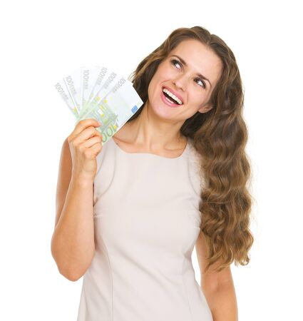 Happy young woman with euros looking up on copy space Stock Photo - 20850329
