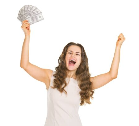 Happy young woman with fan of dollars rejoicing success photo
