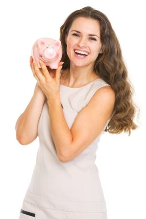 Happy young woman showing piggy bank Stock Photo - 20857182