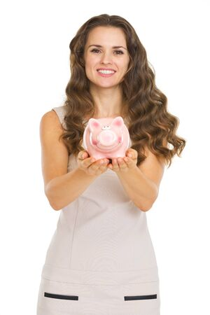 Young woman showing piggy bank Stock Photo - 20671427