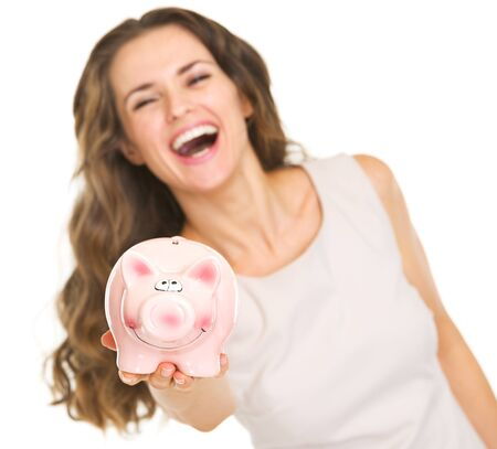 Closeup on piggy bank in hand of smiling young woman Stock Photo - 20671434