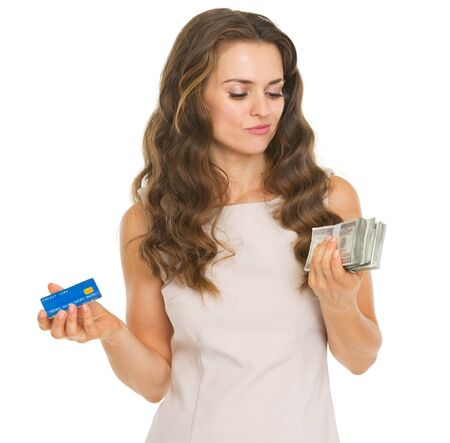 Concerned young woman with credit card and dollars Stock Photo - 20671435