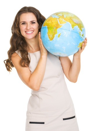 Smiling young woman looking out from earth globe Stock Photo - 20671437