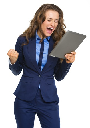 Happy business woman with tablet pc rejoicing success Stock Photo - 21250308