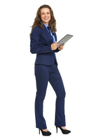 Full length portrait of smiling business woman with tablet pc Stock Photo - 21250316