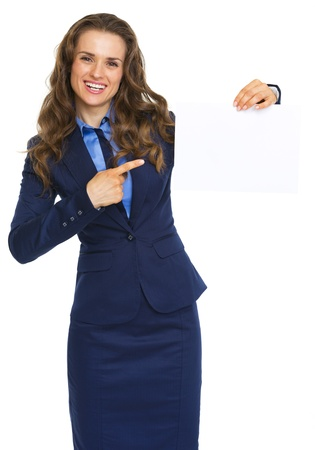 Smiling business woman pointing on blank paper sheet Stock Photo - 21250327