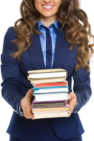 Closeup on business woman with stack of books photo