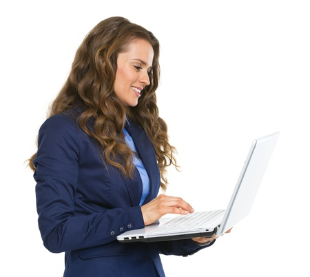Happy business woman working on laptop Stock Photo - 21250426