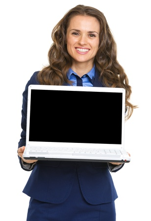 Smiling business woman showing laptop blank screen Stock Photo - 21250430